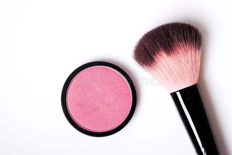 Cosmetic pink blush on and makeup brush. Cosmetic pink blush on and makeup brush with space for text on white background royalty free stock photo
