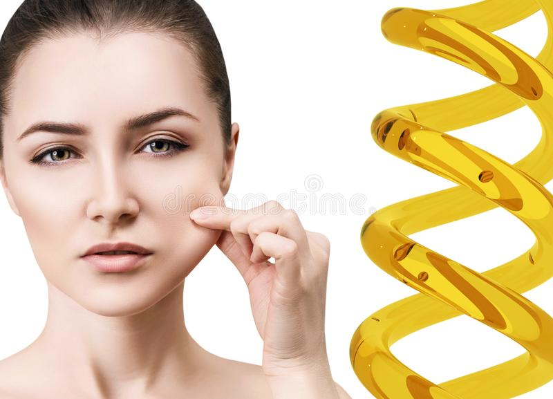 Cosmetic primer in spiral near face of young woman. royalty free stock images