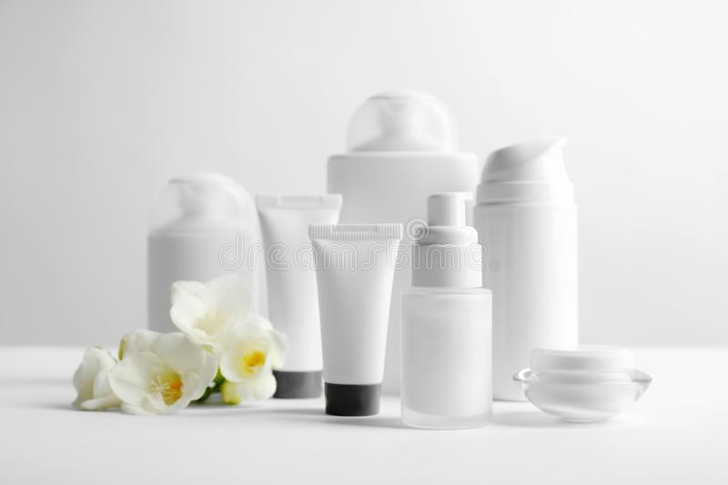 Cosmetic products on table royalty free stock photo
