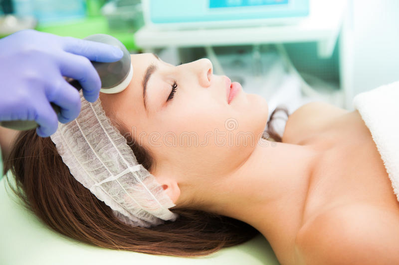 Cosmetic radio-surgery. Woman at Cosmetic radio-surgery treatment royalty free stock image