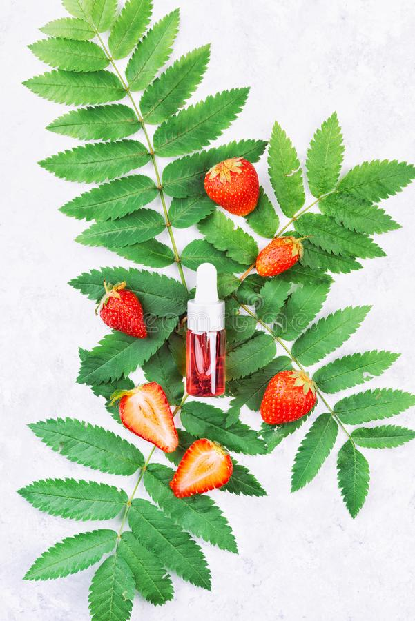 Face skin cosmetics with strawberry extract. royalty free stock photo