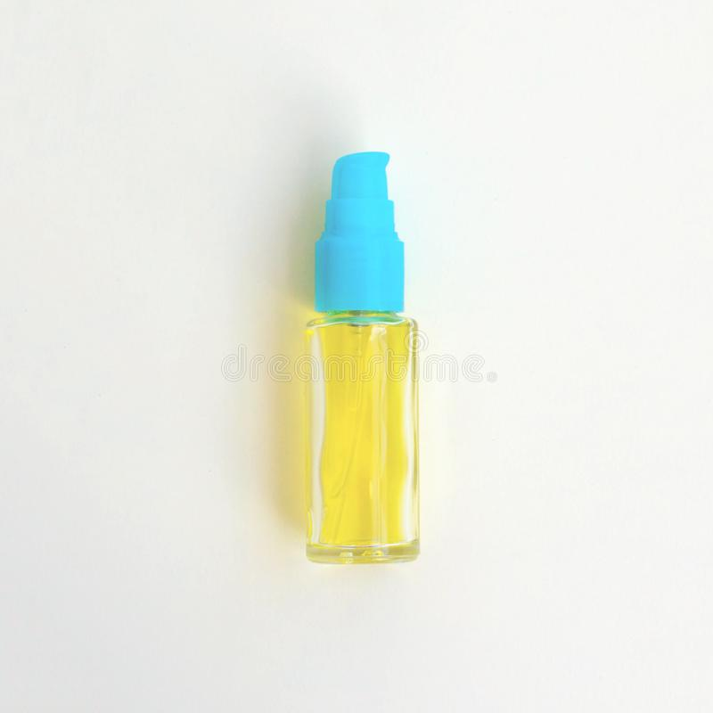 Cosmetic serum for hair and body care. On a light yellow background royalty free stock image