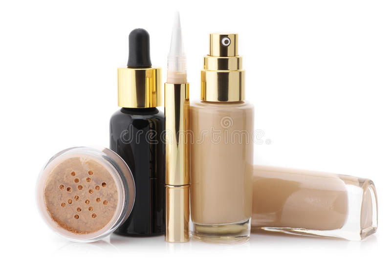Cosmetic set. Two glass bottle of liquid foundation, corrective concealer, loose mineral powder and face serum isolated on white background stock photos