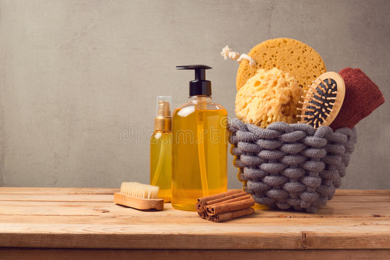 Cosmetic SPA and personal hygiene background with products on wooden table. Cosmetic SPA and personal hygiene background with products on wooden deck table royalty free stock photo