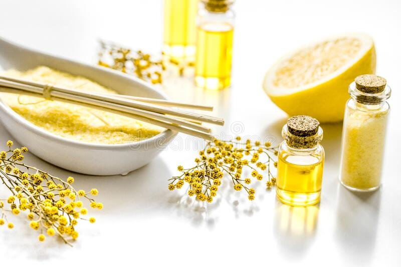 Cosmetic for spa with organic oils and sea salt on white background royalty free stock photo