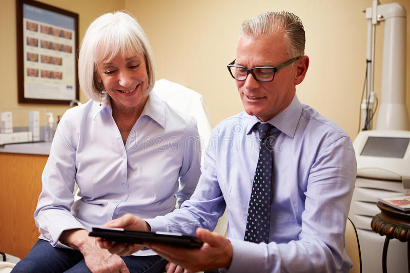 Cosmetic Surgeon Discussing Proceedure With Client In Office royalty free stock photography