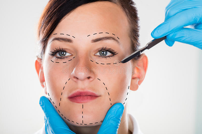 Cosmetic Surgery With Scalpel On Young Woman. Close-up Of A Cosmetic Surgery With Scalpel On Young Woman stock photos