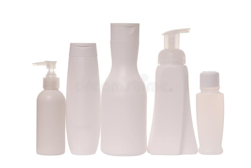 Cosmetic tare, white bottles for shampoo and hair conditioner; stock photography