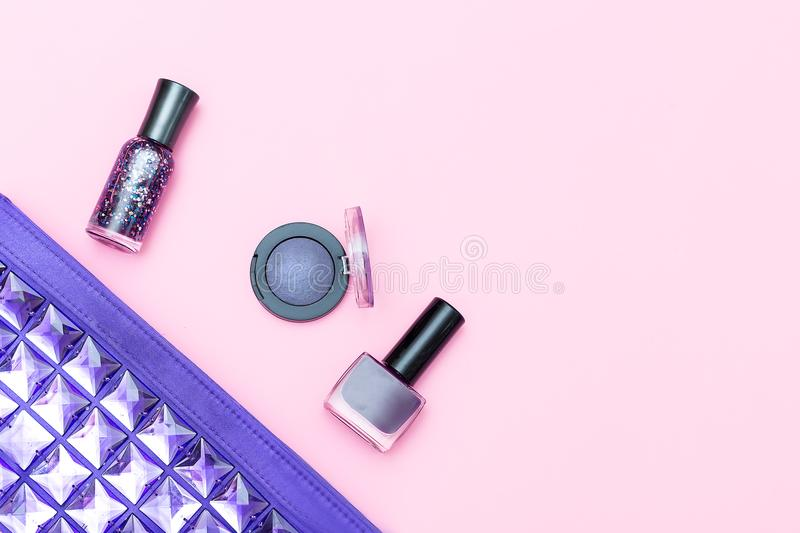 Cosmetic of ultraviolet color and cosmetics on a pink background. Mock up stock photos