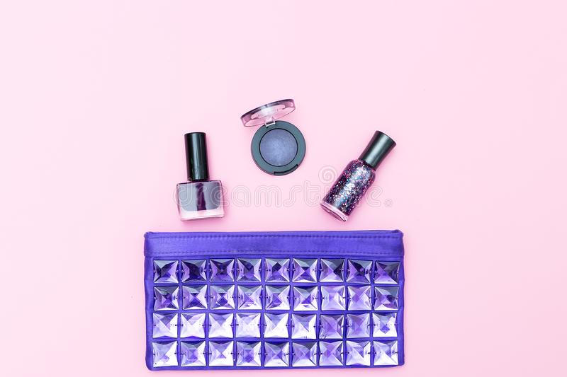 Cosmetic of ultraviolet color and cosmetics on a pink background. Top view stock photography