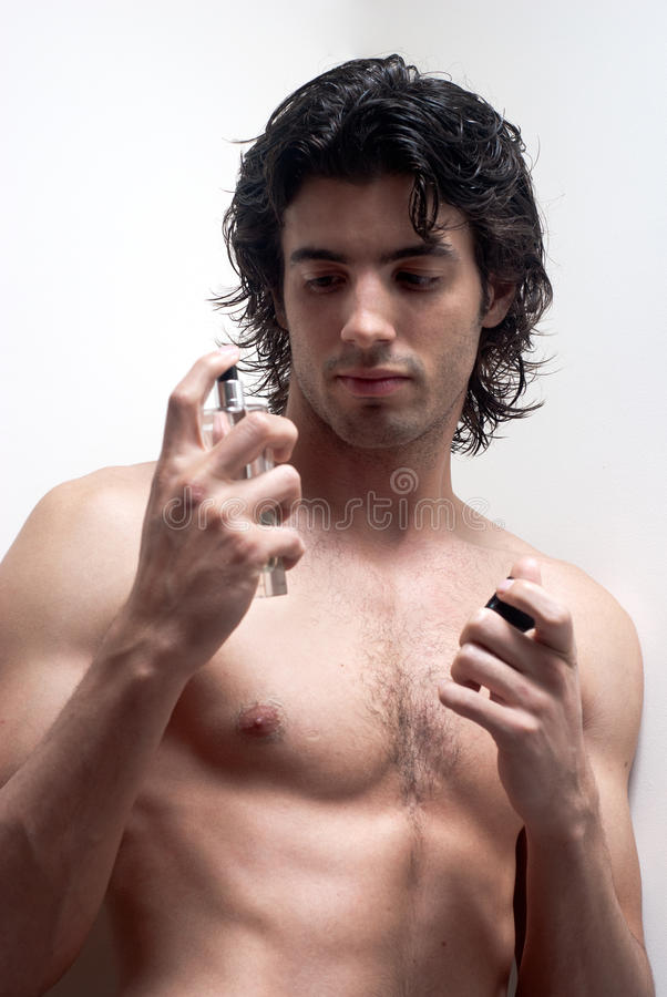 Cosmetic wellness spa man spraying fragrance royalty free stock photo