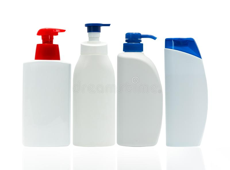Cosmetic white plastic bottle with red and blue pump dispenser isolated on white background with blank label. Set of four skin royalty free stock photos