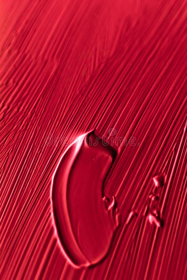 Cosmetics abstract texture background, red acrylic paint brush stroke, textured cream product as make-up backdrop for luxury. Art, branding and makeup concept stock images