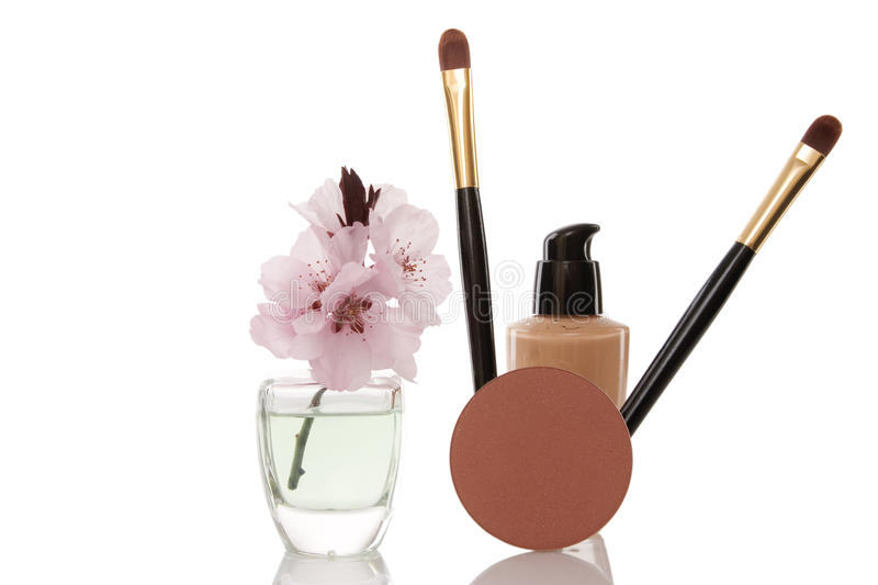 Cosmetics and cherry flower royalty free stock photo