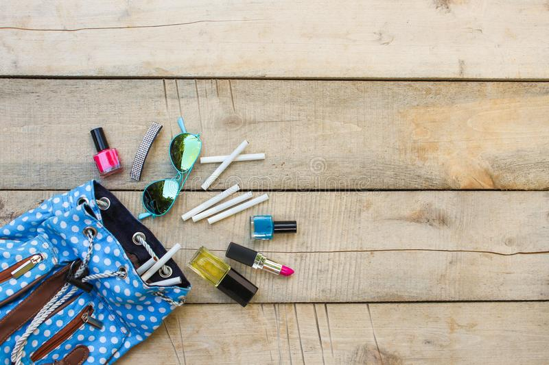 Cosmetics and cigarettes fell out of the backpack of a teenager stock photos