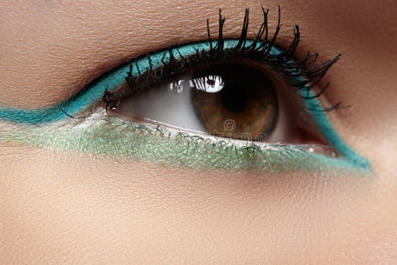 Cosmetics, close-up eye make-up. Fashion eyeshadow stock image