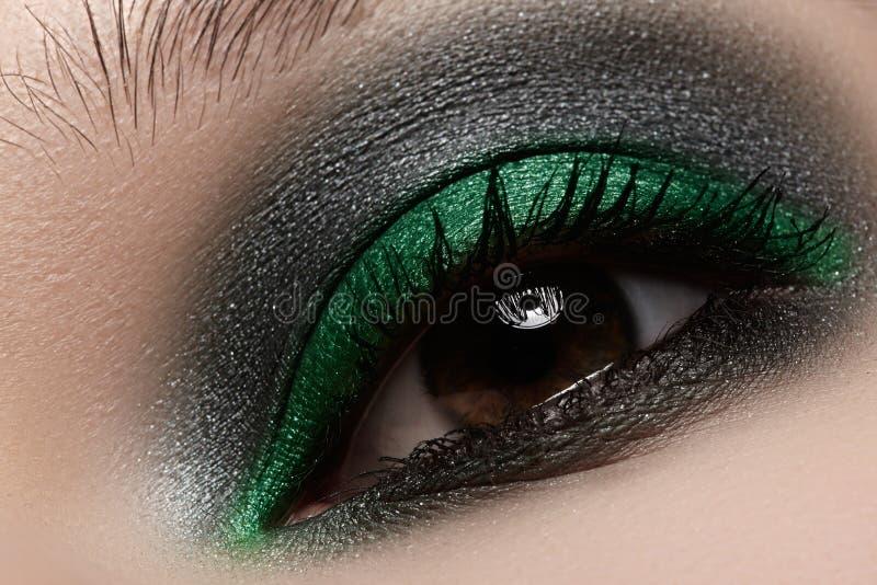 Cosmetics, close-up eye make-up. Fashion shiny green mint eyeshadow royalty free stock photo