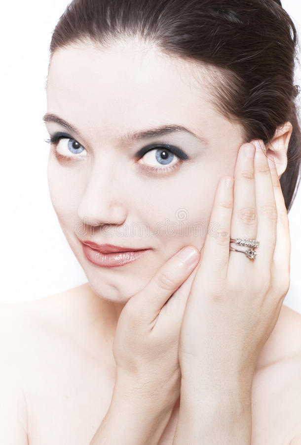 Cosmetics concept. Beautiful young woman face over white background;cosmetics concept stock images