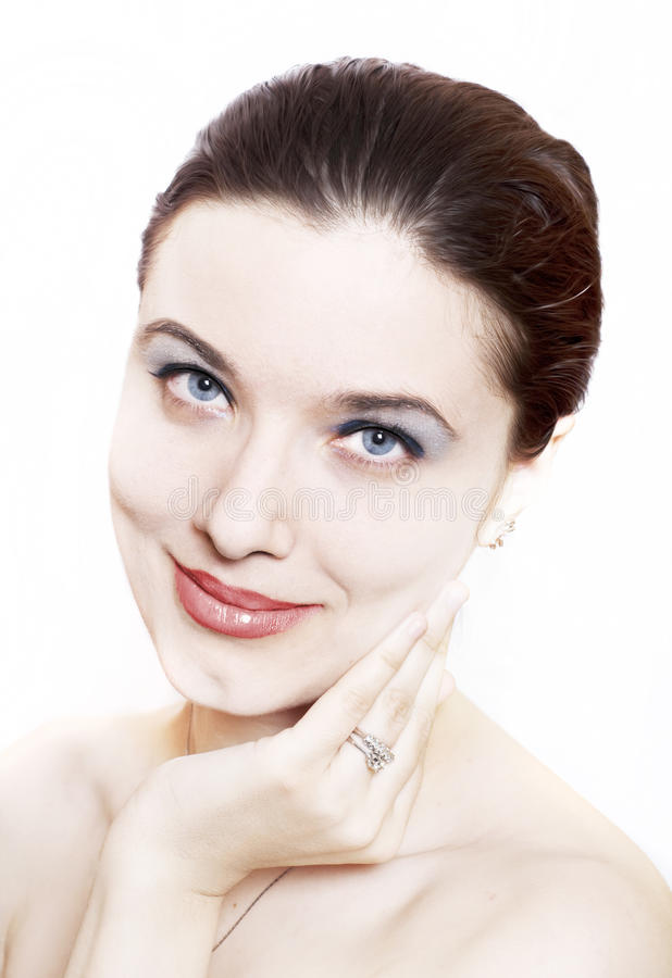 Cosmetics concept. Beautiful young woman face over white background;cosmetics concept stock image