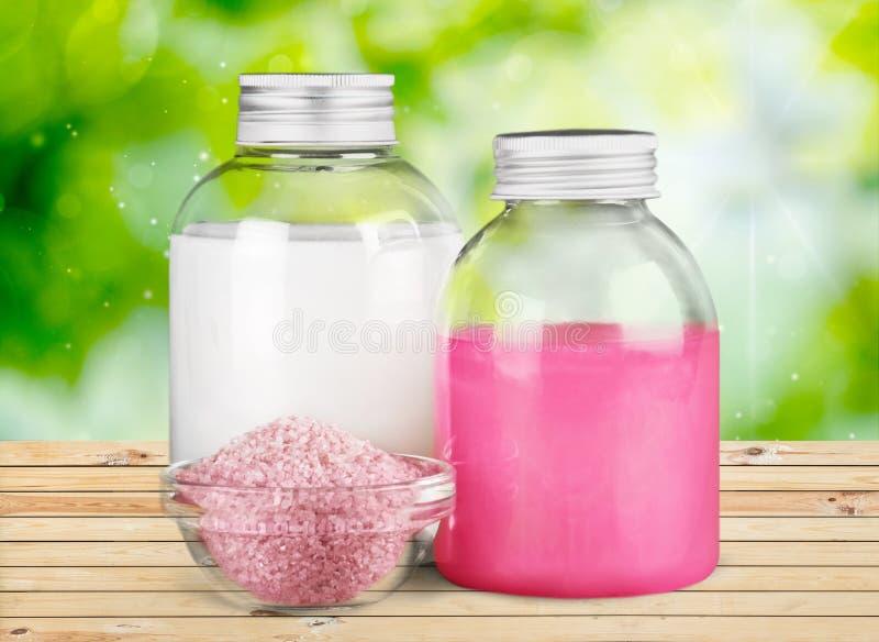 Cosmetics. Bottle moisturizer spa treatment massage oil beauty treatment bath salt royalty free stock photo