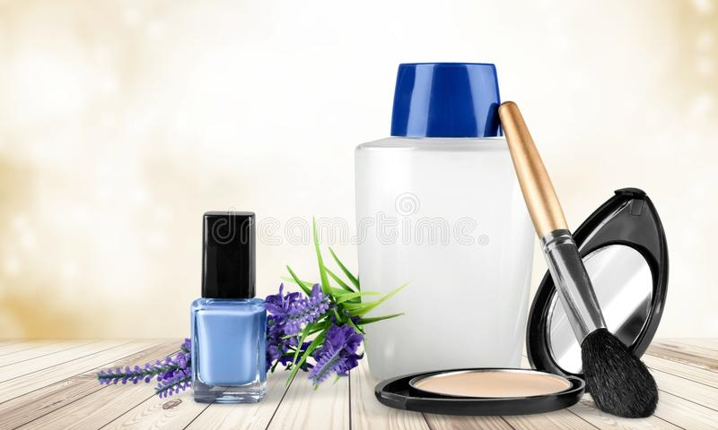 Cosmetics. Make-up toiletries isolated green nail polish group of objects stock image