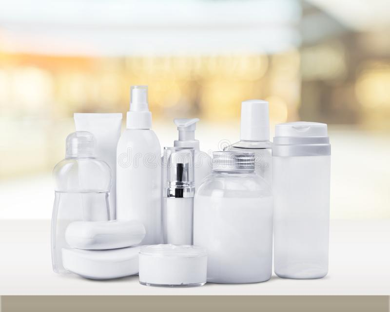 Cosmetics. Moisturizer bottle make-up spa treatment health spa stage makeup royalty free stock image