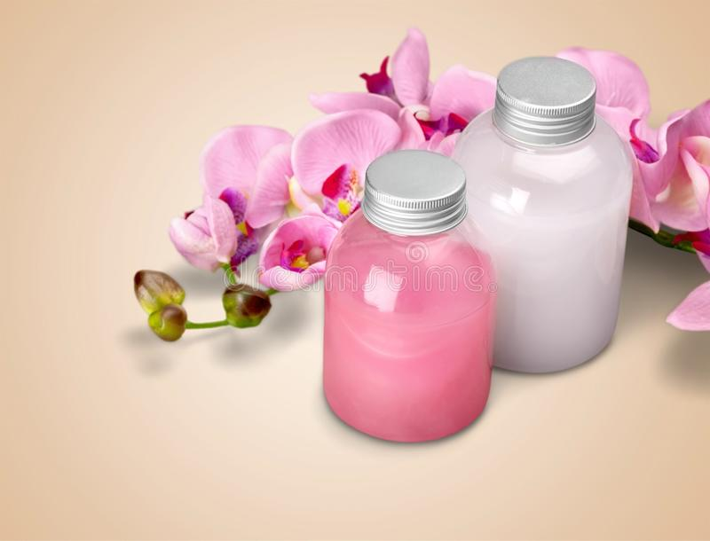 Cosmetics. Shampoo spa treatment orchid flower bottle aromatherapy oil stock images