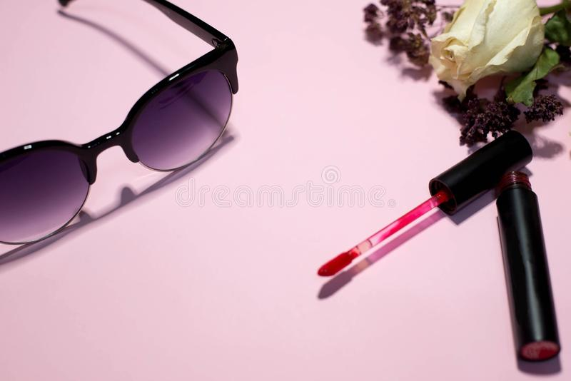 Everything for a woman on a pink background stock photos