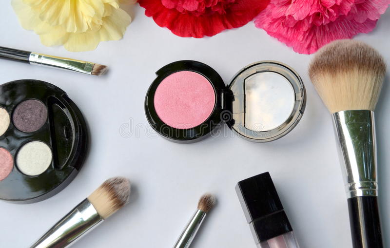 Cosmetics. Eye shadows and brushes for makeup stock image