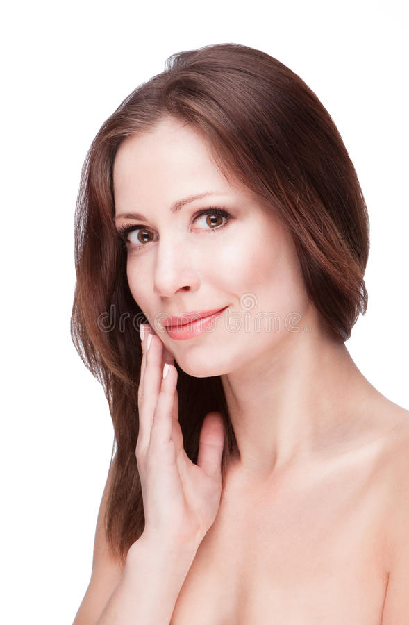 Cosmetics for face skin. Young brunette woman with healthy beautiful skin on white background stock images