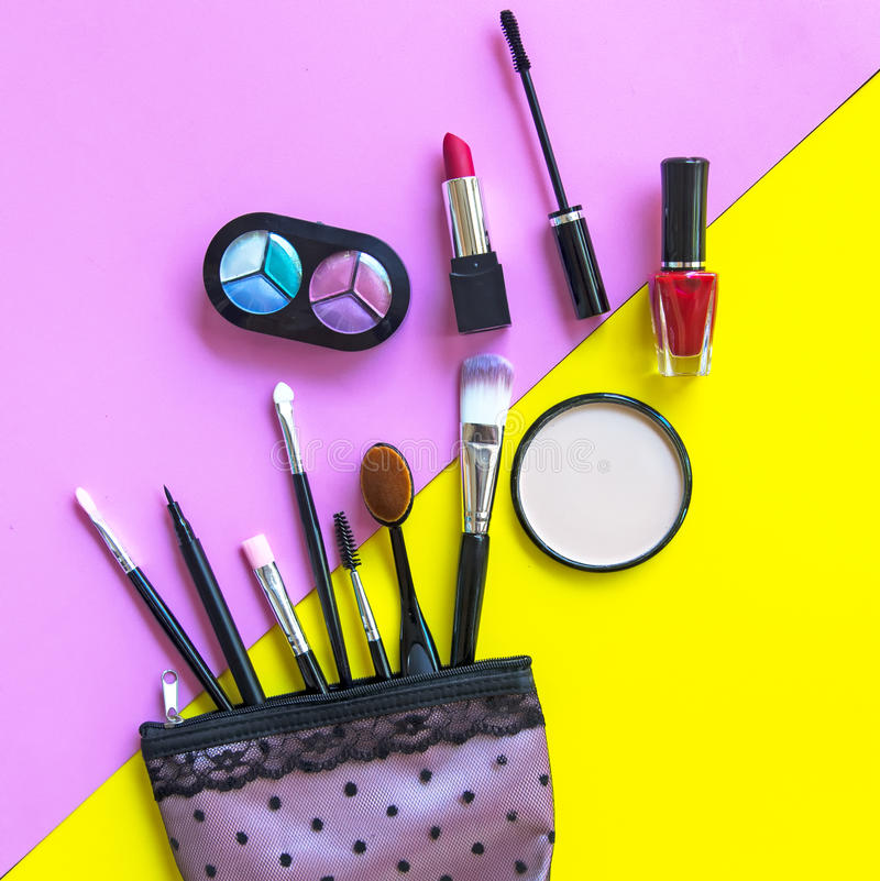 Cosmetics and fashion background with make up artist objects: lipstick, eye shadows, mascara ,eyeliner, concealer, nail polish. Lifestyle Concept royalty free stock photo