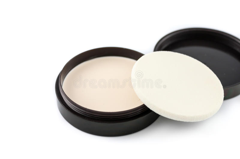 Cosmetics. Foundation makeup with sponge applicator over white royalty free stock photos
