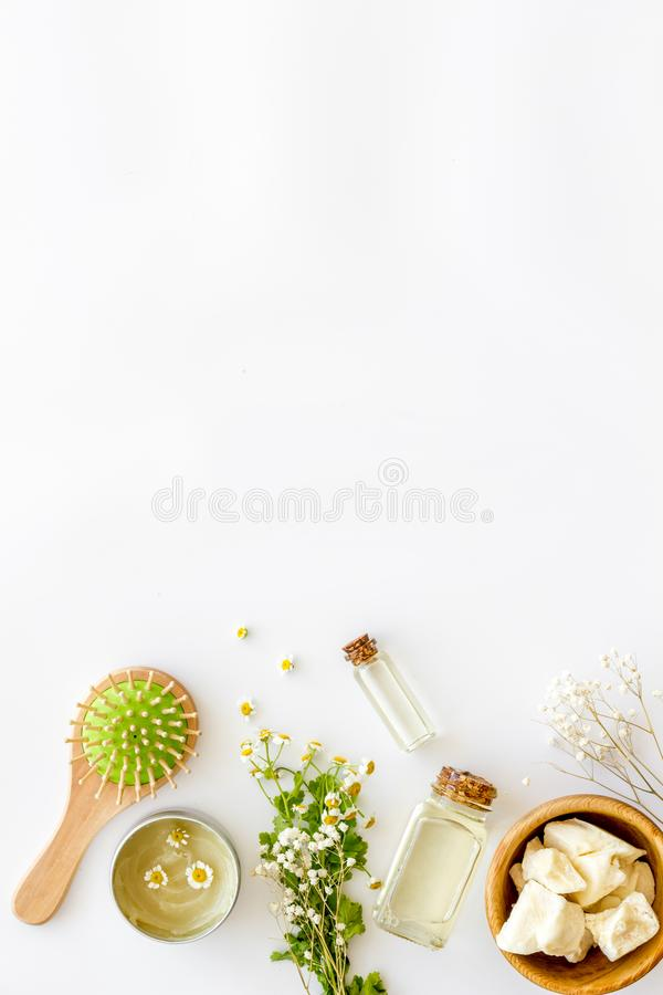 Cosmetics for hair care with jojoba, argan or coconut oil in bottle on white background top view mock up royalty free stock photos