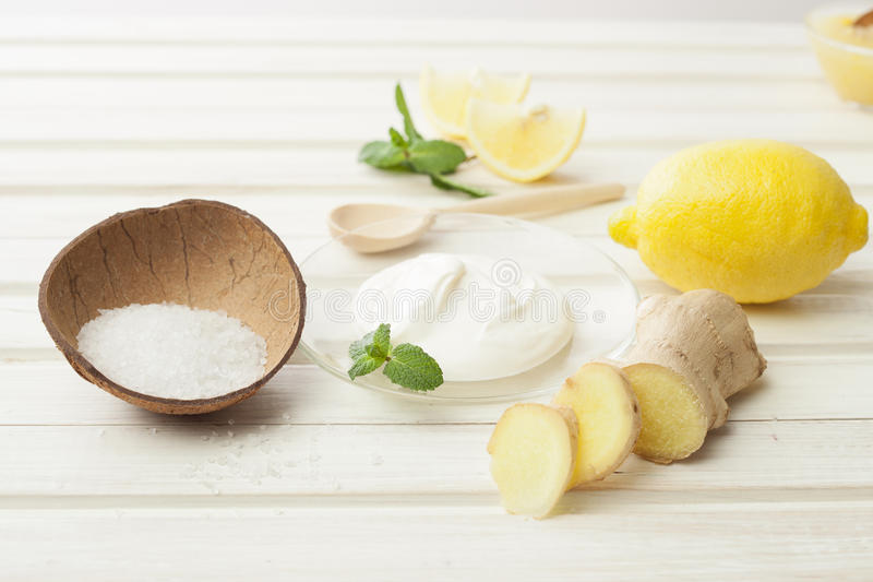 Cosmetics homemade lemon, ginger, salt and essential oils on wh stock photo