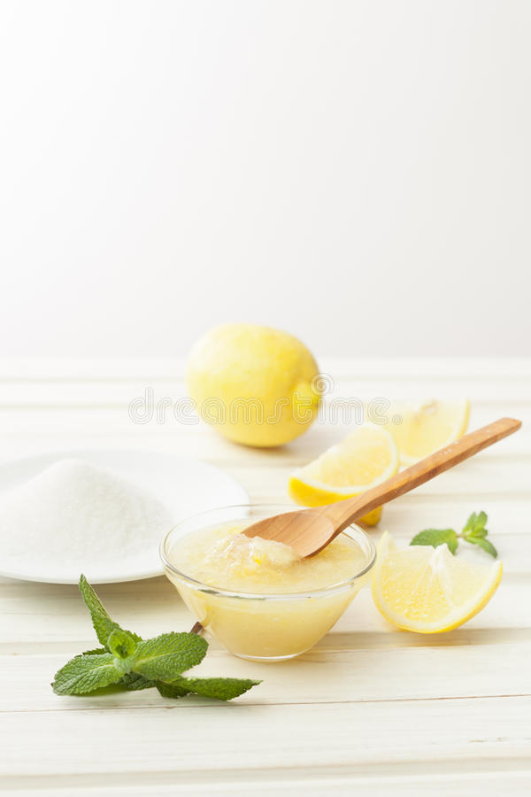 Cosmetics homemade lemon, ginger, sugar and essential oils on w royalty free stock image