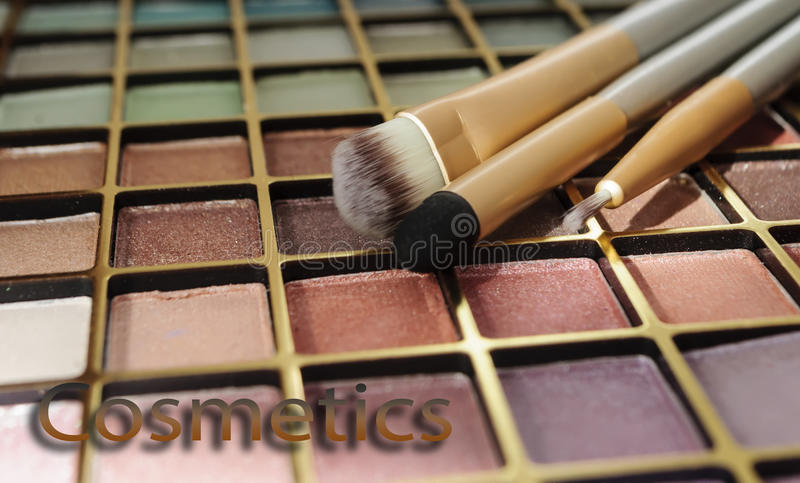 Cosmetics kit for face make-up with inscription royalty free stock photography