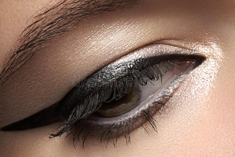 Cosmetics. Macro of beauty eye with eyeliner make-up royalty free stock images