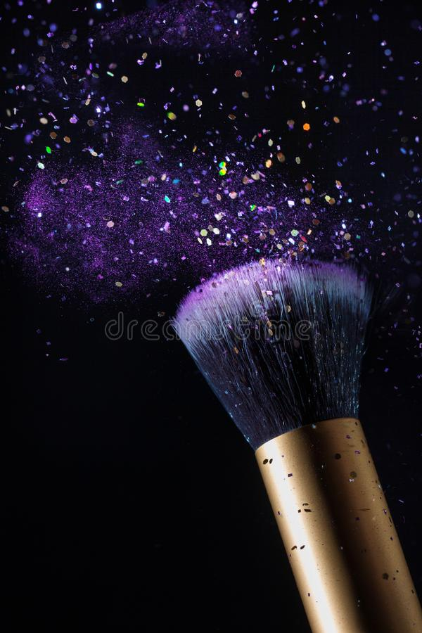 Download Cosmetics Makeup Brush And Powder Dust Explosion Background Stock Photo