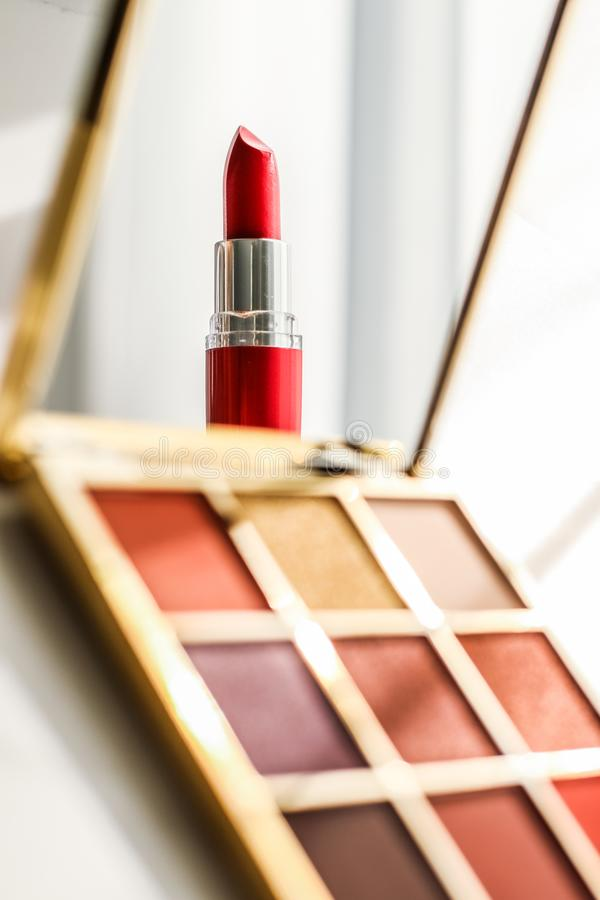 Cosmetics, makeup products set on marble vanity table, lipstick, eyeshadows and make-up brush for luxury beauty and fashion brand stock images