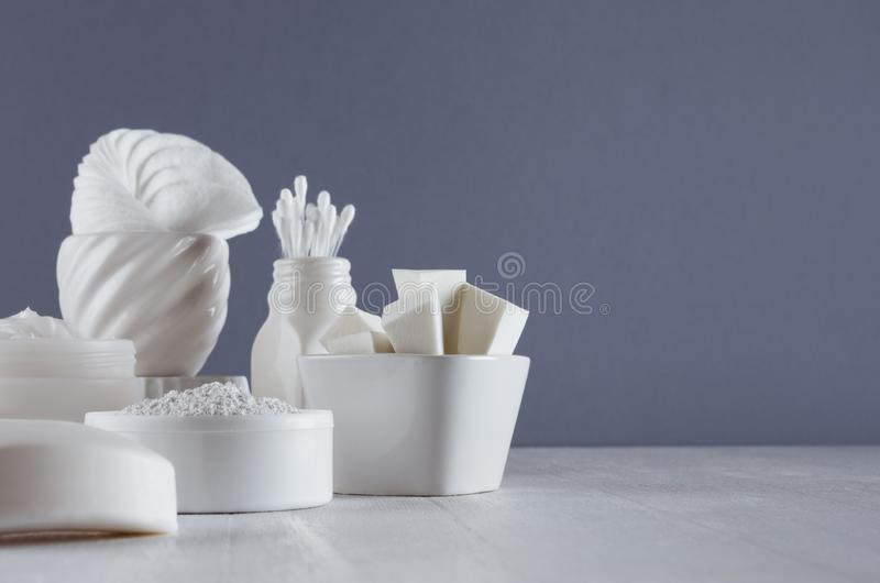 Cosmetics mockup of white products for face skin care in elegant modern grey dark bathroom interior. royalty free stock images