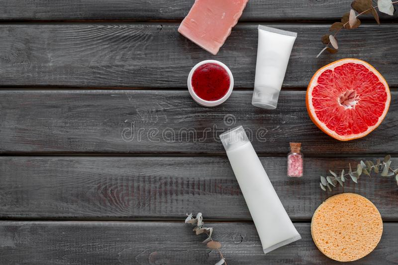 Cosmetics with natural herbal and citrus ingredients on gray wooden background top view copyspace stock photography