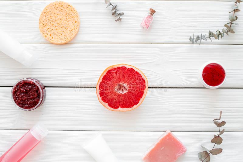 Cosmetics with natural herbal and citrus ingredients on white wooden background top view royalty free stock images