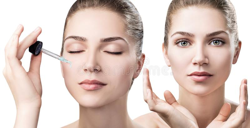 Cosmetics oil applying on face of young woman. stock photography