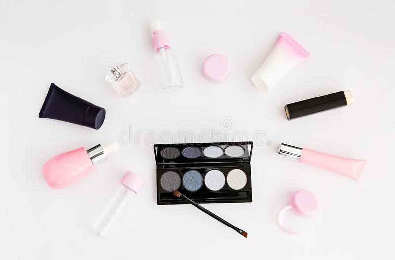 Cosmetics, perfume, different care creams and patelle with eye shadows. Set of woman`s cosmetics. Women`s secrets. Cosmetics, perfume, different care creams and stock images