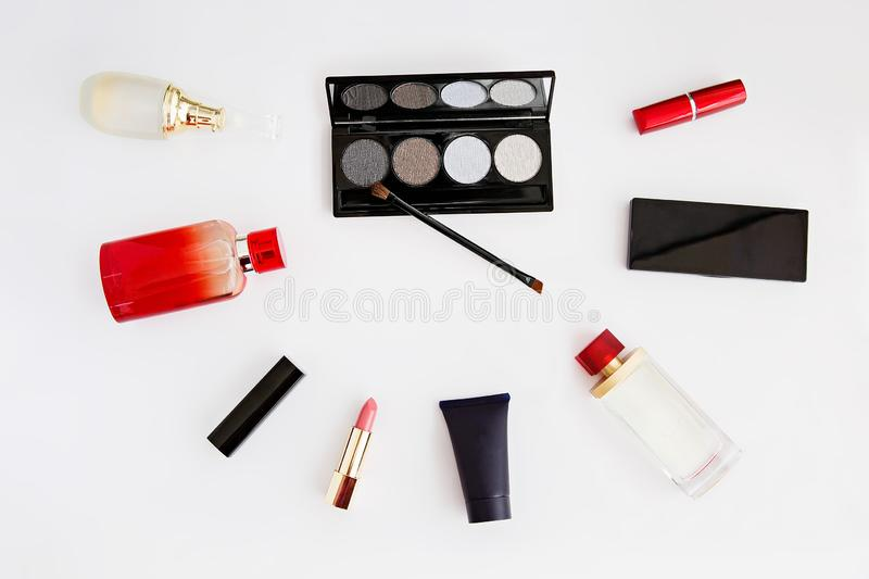 Cosmetics, perfume, different care creams and patelle with eye shadows. Woman`s cosmetics. Women`s secrets. Cosmetics, perfume, different care creams and patelle stock photography