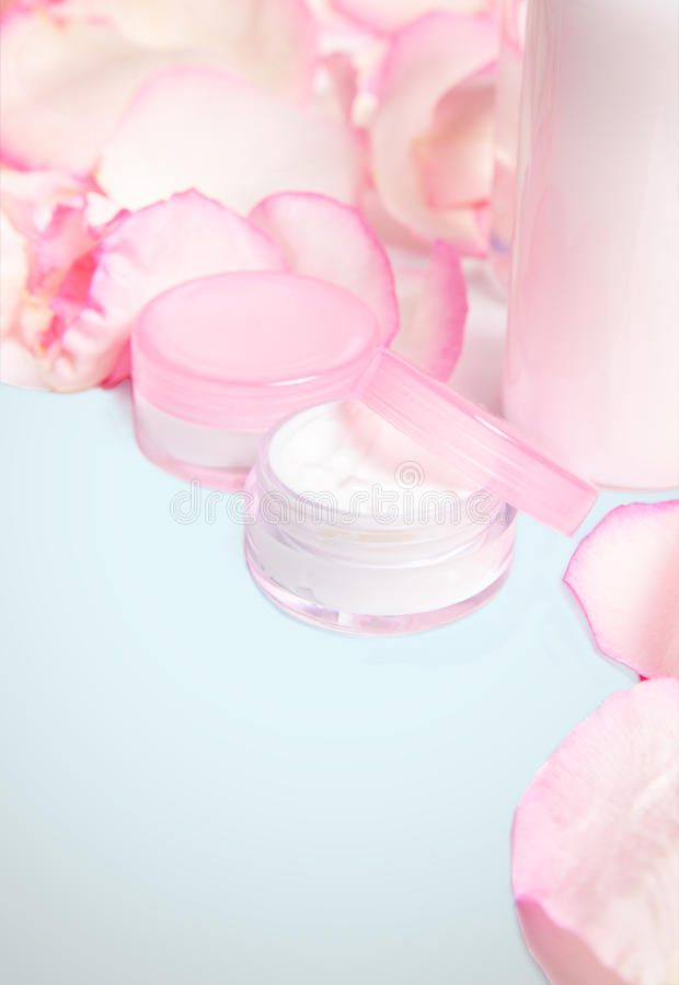 Cosmetics with rose petals royalty free stock photography