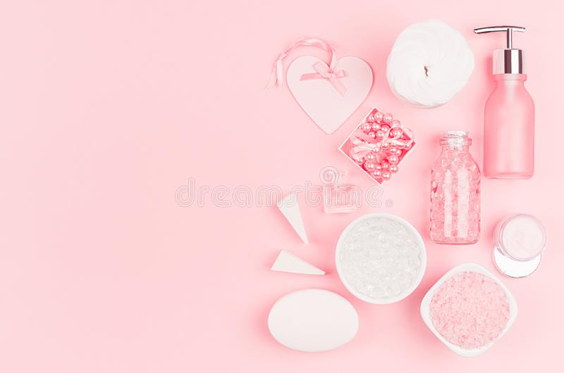 Cosmetics for salon aromatherapy, massage or bathroom - bath salt, cream, essential oil, soap, bowls, bottles, jewelry, heart. stock images