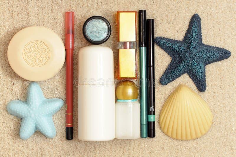 Cosmetics on the sea sand stock photos