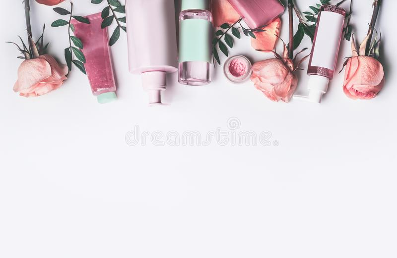 Cosmetics set with Rose essential oils: toner, serum, essence, moisturizer and and others on white stock photos