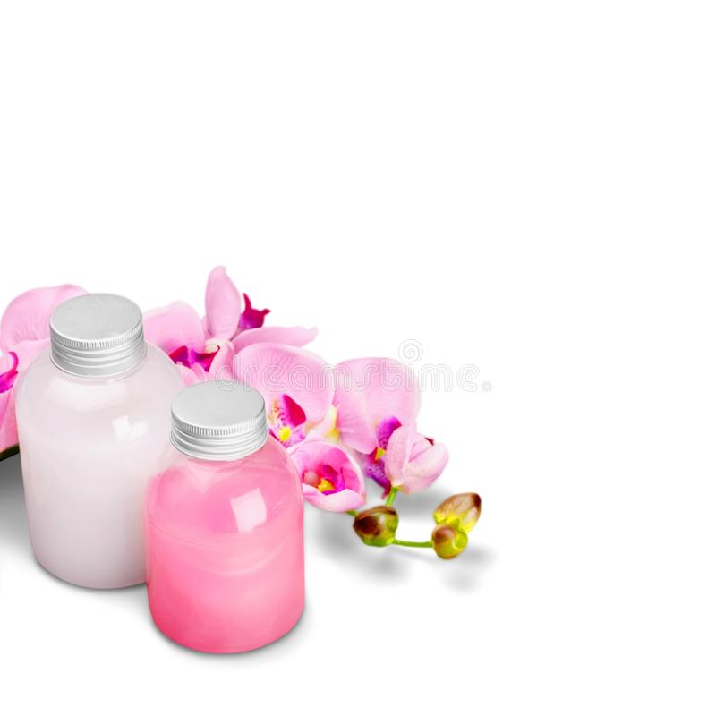 Cosmetics. Shampoo spa treatment orchid flower bottle aromatherapy oil royalty free stock photos